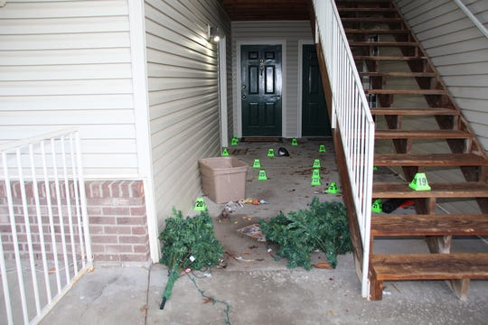 Louisville Metro Police's crime scene photo shows the location of shell casings outside of Breonna Taylor's front door.