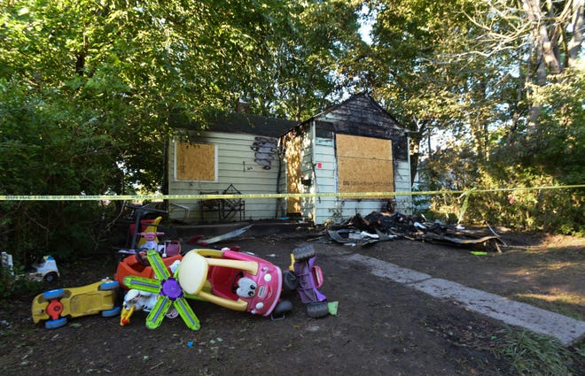 The aftermath of an overnight fire, seen Friday morning, Sept. 4, 2020, in the 1400 block of Elizabeth Street near Clifford Street on Lansing's east side.