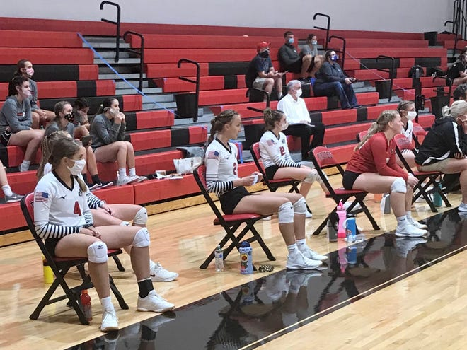The bench for the Cardington volleyball team is socially distanced for a match against Highland this fall.