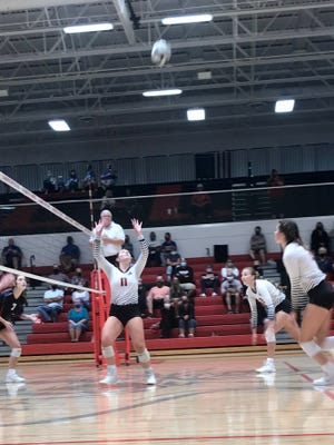 Cardington setter Kyleigh Bonnette sets a ball during a match with Highland last week. She recently went over 2,000 career assists and won the Marion Star Best of the Week Performer Poll.
