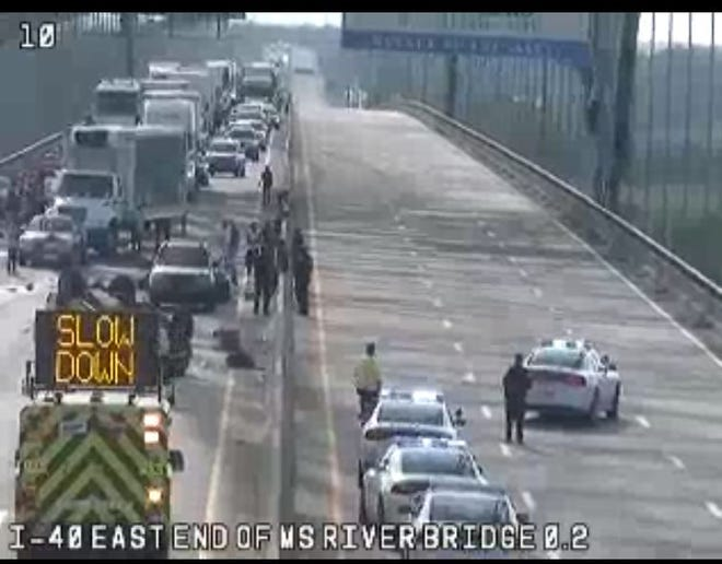 Traffic camera footage shows the Hernando de Soto bridge blocked to traffic in both directions after a pickup truck overturned Friday evening.