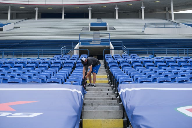 A Liberty Bowl staff member closes off rows of seating in preparation for the Memphis Tigers' season-opening football game, Friday, Sept. 4, 2020, in Memphis, TN.