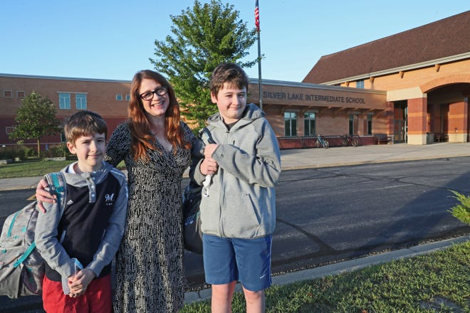 Katie Newcomb of Oconomowoc, center, drops off her children, Wyatt age 11, left, and Dillon, 12, right, at Silver Lake Intermediate School.