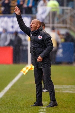 New York Red Bulls head coach Chris Armas reacts during first half of an MLS soccer Eastern Conference first-round playoff match against the Philadelphia Union, Sunday, Oct. 20, 2019, in Chester, Pa. The Union won 4-3 in extra time. (AP Photo/Chris Szagola)