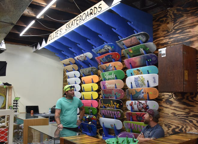 Jimi Tickle, left, at his new Ollie Skateboards shop in the High Cotton building in Downtown Dickson.