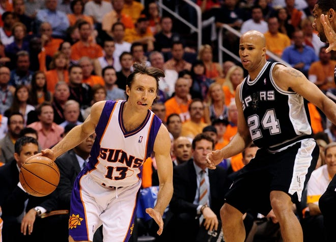 May 3, 2010; Phoenix, AZ, USA; Phoenix Suns guard (13) Steve Nash moves the ball past San Antonio Spurs forward (24) Richard Jefferson in game one in the western conference semifinals of the 2010 NBA playoffs at the US Airways Center. The Suns defeated the Spurs 111-102. Mandatory Credit: Mark J. Rebilas-USA TODAY Sports