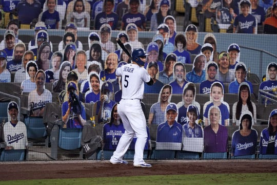 Los Angeles Dodgers shortstop Corey Seager among the cutouts. Dodger Stadium, Sept. 2020