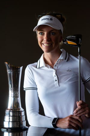 Sophia Popov, the winner of the 2020 Women's British Open golf tournament, poses with the her trophy from the tournament at the Firerock Country Club in Fountain Hills, Ariz. on Sep 1, 2020.