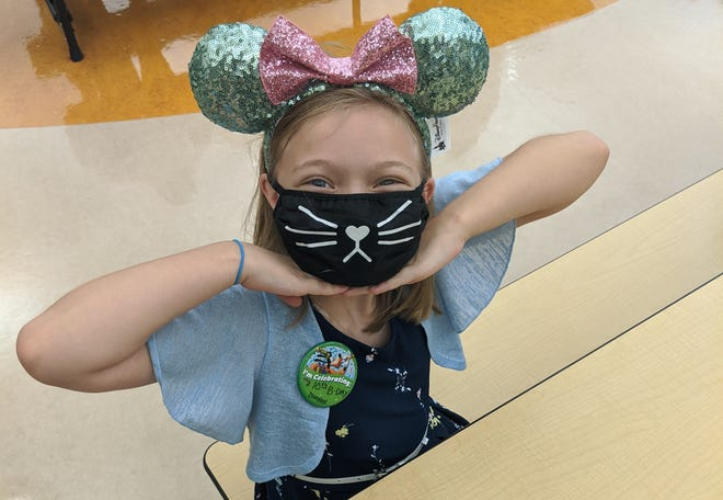 Sophia Hargrove, a student at Bataan Memorial Elementary, shows off her new mask as she awaits the first day of school.