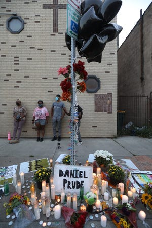 Free the People Roc, Community Justice Initiative and supporters marched to Jefferson Ave, on Sept. 3, 2020 protesting the death of Daniel Prude and rallying for Black lives matter.  Candles and flowers have been left over the past two days at the site where Prude encountered police.