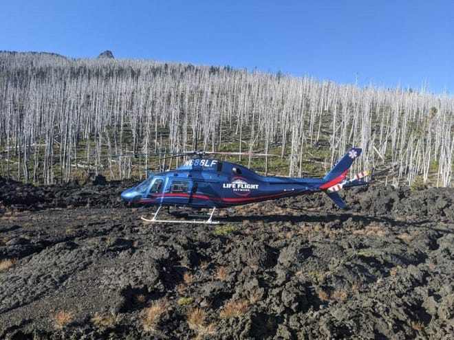 A Life Flight helicopter helps in the rescue of a Salem hiker who suffered a heat-related medical emergency.
