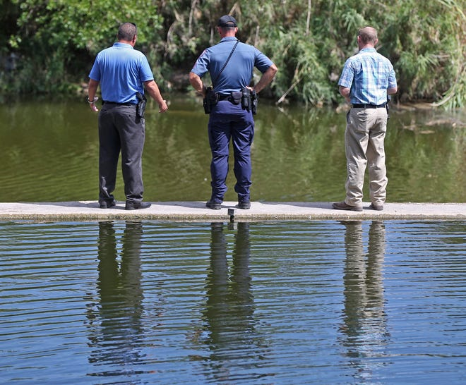 Officers with the San Angelo Police Department investigate after a man's body was found in the Concho River in downtown San Angelo on Friday, Sept. 4, 2020.