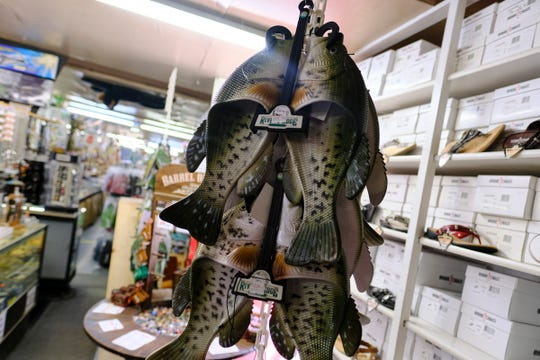 Fish-shaped sandals are a popular item at Treasure City in Royalton.