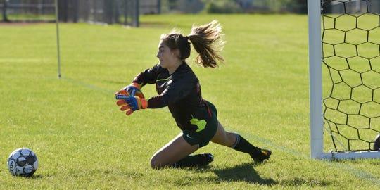 Sauk Rapids goalie Maggie Fernholz dives to make a save against Alexandria Thursday, Sept. 3, 2020, at Sauk Rapids High School.