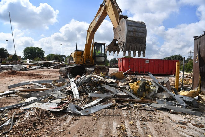 Charlie Peters of ZAC Corp. uses heavy equipment to demolish the former Golden Corral property on Kemp Boulevard. The land will be the site of a new Panera Bread restaurant.