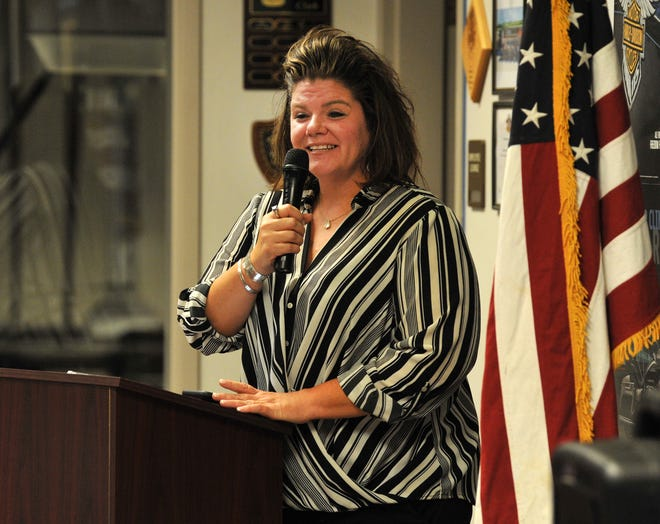 Michelle Smith, a representative for Texas Senate District 30 candidate Shelley Luther, spoke to a small crowd during a Tea Party candidate forum held at the Harley Davidson Thursday evening.