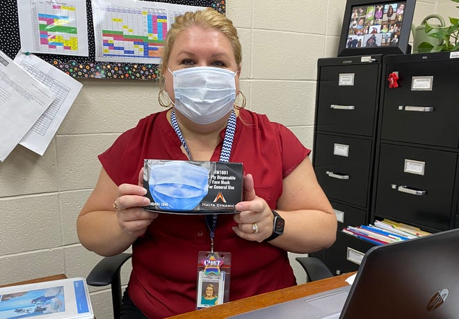 Megan Miller, principal at Beverly-Center Elementary School in Beverly, with a face mask donated to schools across Ohio by Malta Dynamics.