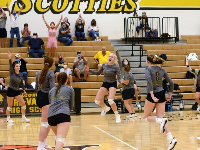 River View celebrates after defeating Tri-Valley in four sets on Thursday night in Dresden.