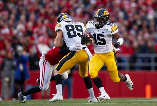 Iowa running back Tyler Goodson carries runs the ball against Wisconsin during their 2019 game at Camp Randall Stadium.