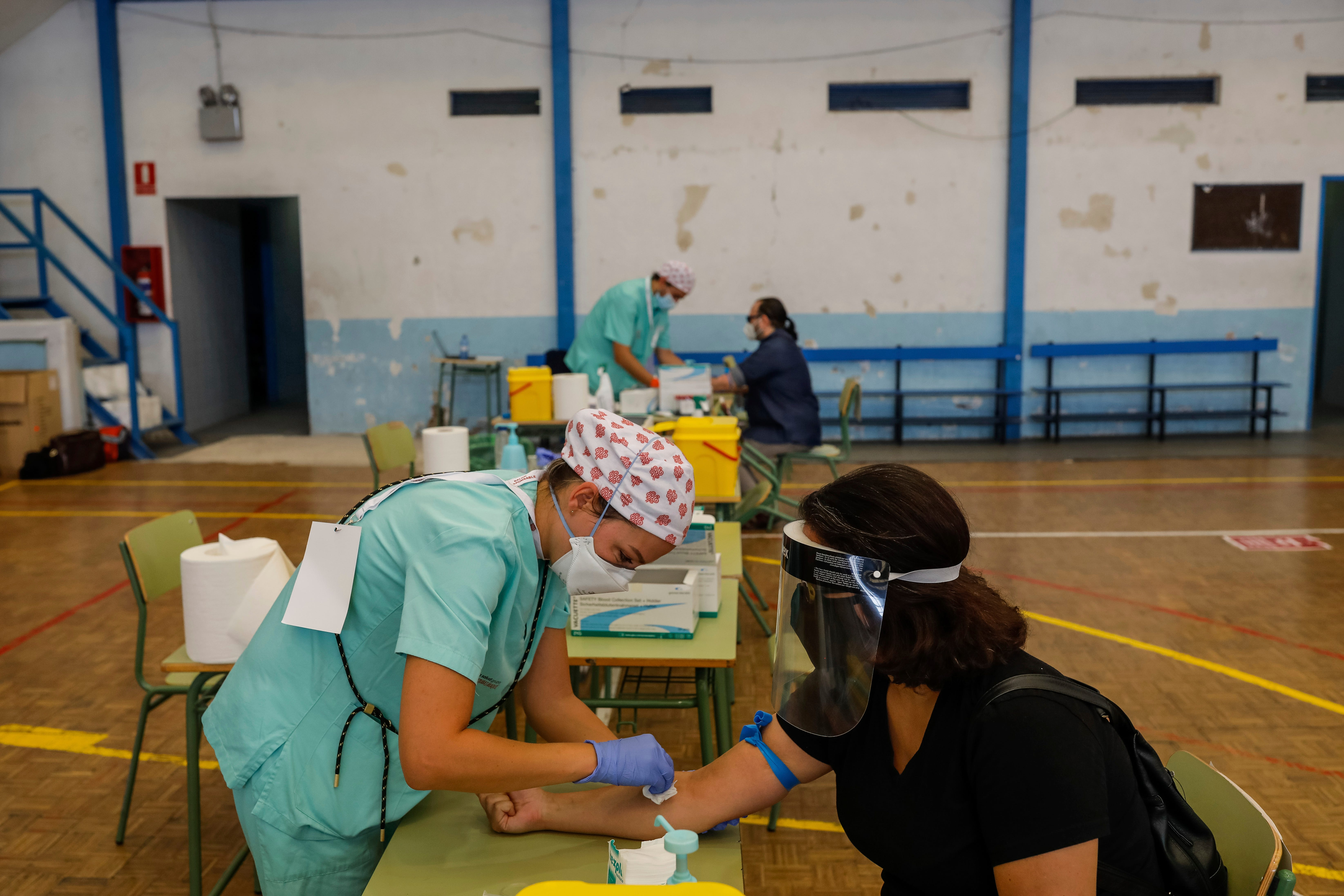 Teachers and auxiliary staff take COVID-19 tests in Madrid, Spain.