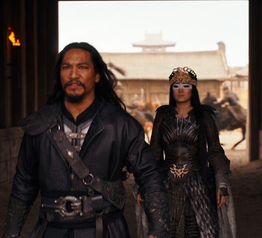 "Jason Scott Li (L) is Böri Khan in ""Mulan"" working with Xianniang (Gong Li) to defeat the Emperor."