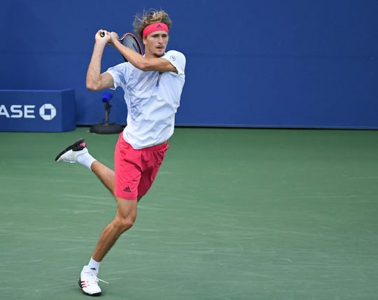 More than three hours after it was set to begin, the match between No. 5 Alexander Zverev, above, and No. 32 AdrianMannarino finally began on Arthur Ashe Stadium.