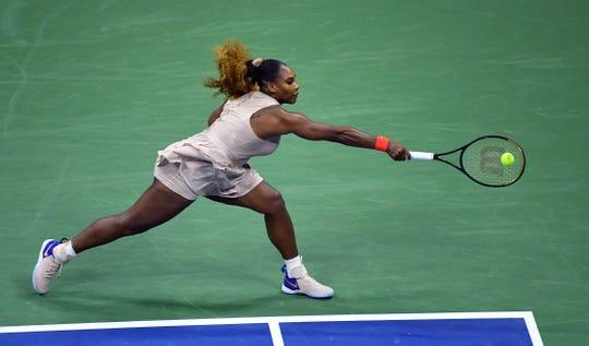 Serena Williams returns against Margarita Gasparyan in her 6-2, 6-4 win.