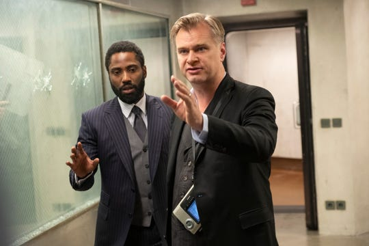 """Christopher Nolan (right) and John David Washington collaborated on the set of """"Tenet"""" and also quoted """"Wayne's World"""" to each other."""