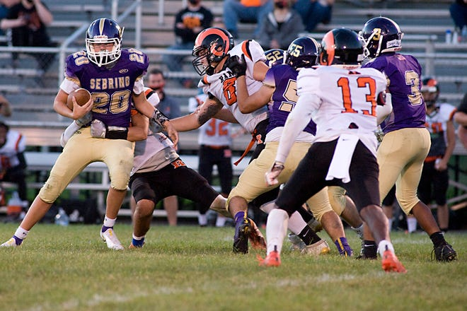 Sebring McKinley's Dylan Johnson scrambles for extra yardage in a Mahoning Valley Athletic Conference game against Mineral Ridge last Friday.