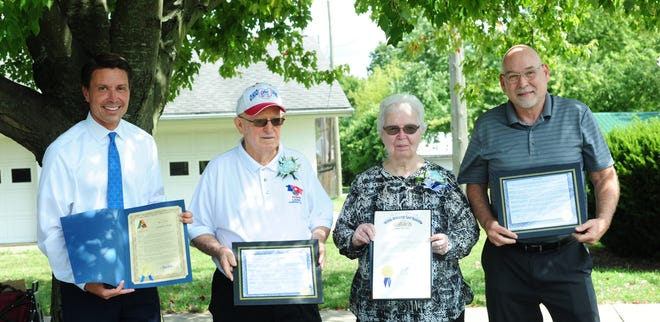 From left, Ashland Mayor Matt Miller, Bill and Betty Harner, and Ashland County Commissioner Jim Justice at Kendig Park in Hayesville with the Harners' award  from the Ohio District 5 Area Agency on Aging. They are the 2020 Ashland County Outstanding Senior Citizen Award recipients.