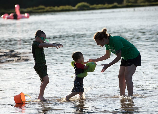 A mother and her children play in the water Friday evening at Raccoon Creek State Park. Tim Ishman, director of Beaver County Recreation and Tourism, noted that overall park use has increased during the COVID-19 pandemic.