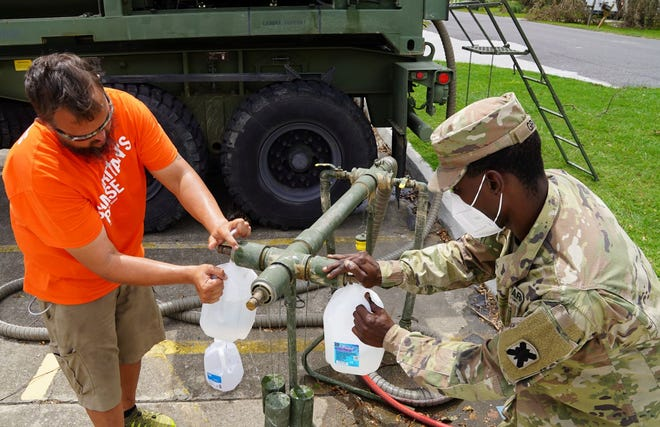 Louisiana National Guard provides clean drinking water to volunteers.