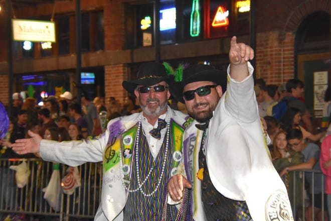 Members of the Krewe of Kajuns celebrate during their parade last February in Houma. The 2021 Carnival celebration is in doubt due to the ongoing coronavirus pandemic.