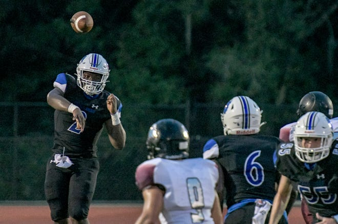 Mount Dora Christian Academy quarterback Ty'Quan Wiggins throws the ball during Friday's game Orlando Faith Christian at Bulldogs Stadium in Mount Dora. [PAUL RYAN / CORRESPONDENT]