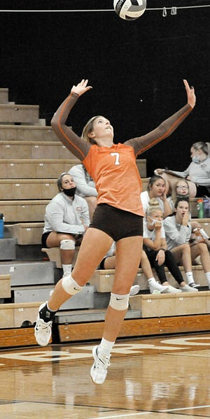 Meadowbrook High's Camden Black (7) serves the ball during East Central Ohio League volleyball action versus Claymont Mustangs at Meadowbrook High School Saturday afternoon. No results from the match were available at press time.