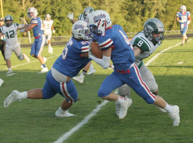 Sawyer Pritt takes off after getting a block from Luke Vess on 15-yard touchdown reception during the Knights' 63-0 rout of Madison.