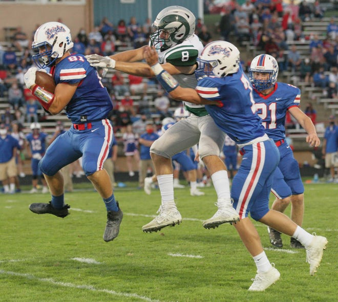 Logan Kula (81) intercepts a pass for a pick-six during West Holmes' 63-0 win over Madison earlier this season.