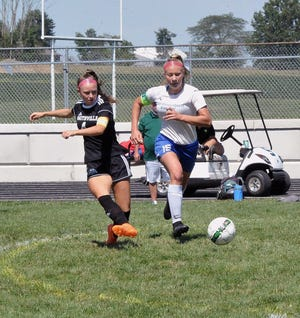 First-team All-Daily Record honorees Jillian Newlan (left) and Bri Troyan battle in the midfield during the regular season.