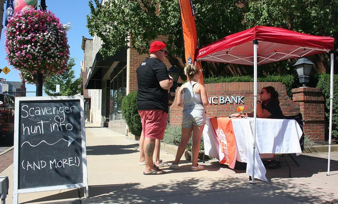 Ashland Main Street Executive Director Sandra Tunnell answers questions about about the organization's scavenger hunt Saturday downtown.