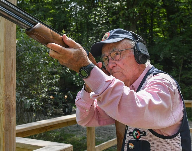 Stark County native Joe Toot, Jr., 85, demonstrates how he readies to fire his shotgun at clay targets at Hill 'n Dale Club in Medina County. Toot has had a lifelong passion for sporting clays. He competes nationally and internationally, although COVID-19 has slowed his travel schedule this year.