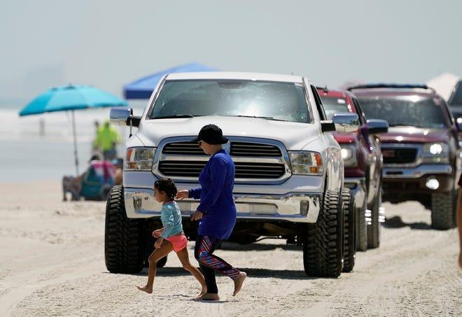 Trucks cruise the beach in Daytona Beach Shores, Saturday, Sept. 5, 2020.
