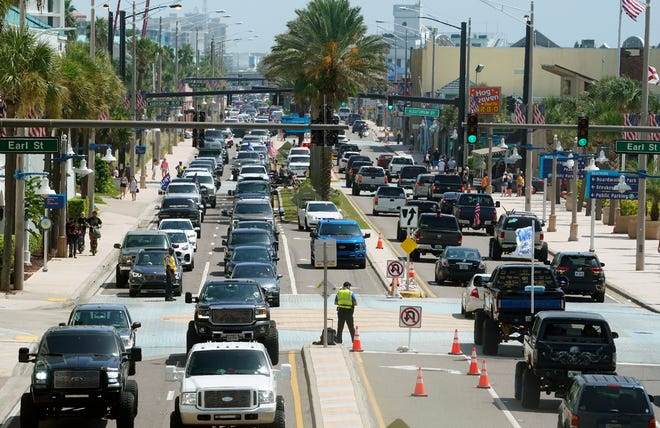 Vehicles back up on Atlantic Avenue as truck fans and holiday weekend visitors cruise the strip in Daytona Beach. The big crowd kept police officers busy with traffic control and other issues.