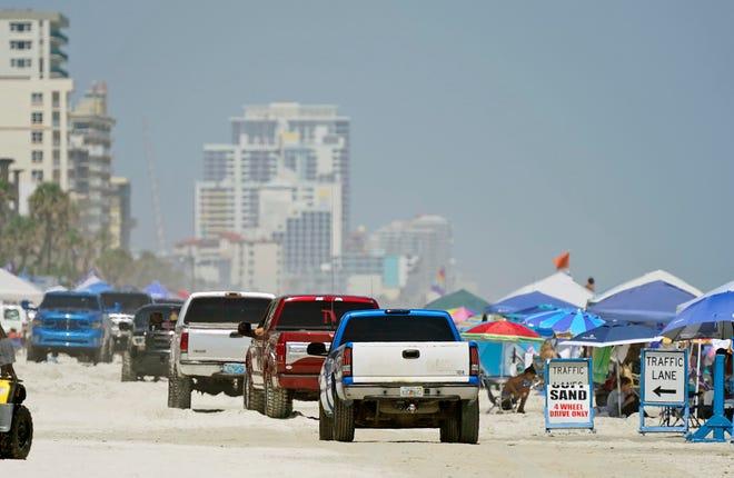 Trucks in town for the Daytona Truck Meet cruise the beach in Daytona Beach Shores on Saturday.