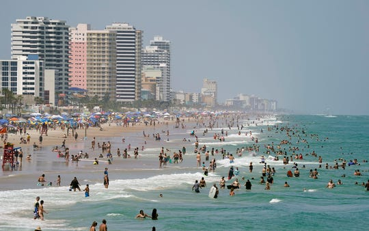 Beachgoers pack the sands of Daytona Beach on Saturday.