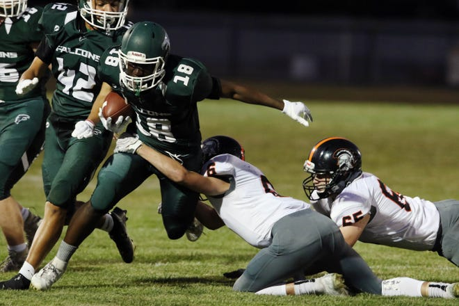 West Burlington-Notre Dame's Travain Donaldson (18) breaks a tackle during the first half of their game against Fairfield High School, Friday Sept. 4, 2020 at West Burlington's Bill Nelson Field.