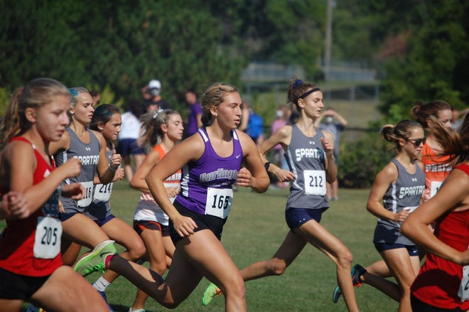 BHS sophomore Ella Schroeder charges through the pack after the gun Saturday at the Spartan Invitational in Bettendorf.