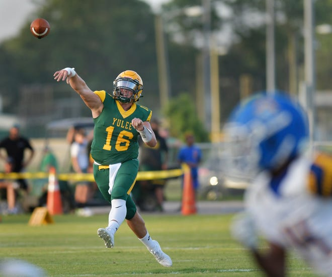 Yulee quarterback Justice Pope (16) throws a pass during the COVID-19 delayed high school football season opener against Fernandina Beach on Friday night, September 4, 2020 in Yulee, Florida.  [Will Dickey/Florida Times-Union]