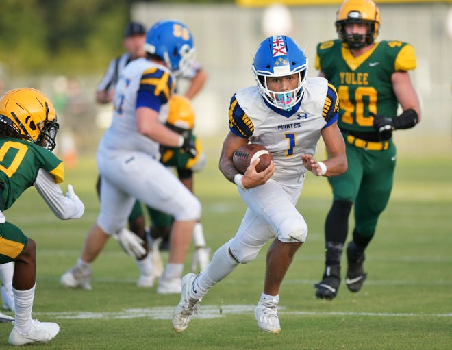 Fernandina Beach quarterback Cam Miller (1) scrambles for yardage during the COVID-19 delayed season opener against Yulee on Sept. 4. Miller, who also plays defensive back, is among Northeast Florida's most-recruited prospects for the 2022 class.