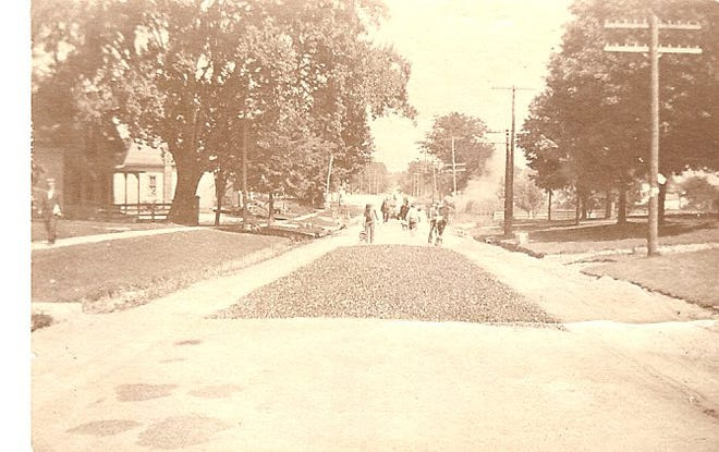 The first road to be paved from the Hurd Store at the Aurora Depot past Harmon's store in the town center. This photo was taken near 260 S. Chillicothe Road.