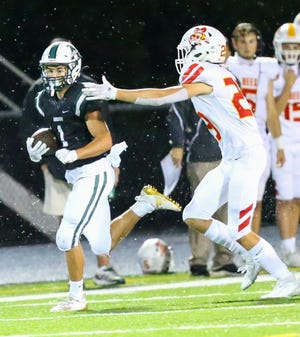 Aurora wide receiver Jacob Matousek looks for running room during week one against Brecksville-Broadview Heights. Aurora scored a 12-7 win at Revere Sept. 4 to earn its first win of the season.